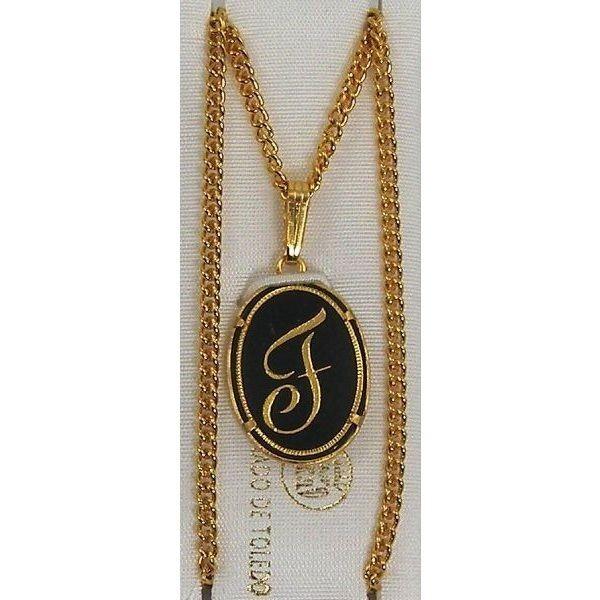 damascene gold letter f oval pendant